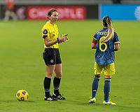 ORLANDO, FL - JANUARY 22: Referee Danielle Chesky speaks to Daniela Montoya #6 during a game between Colombia and USWNT at Exploria stadium on January 22, 2021 in Orlando, Florida.