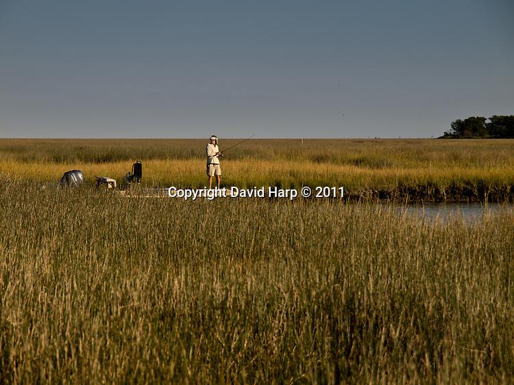 Bob Baugh fishes in a Smith Island marsh gut