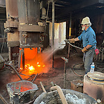 """First pour of hot iron in the 21st century at the historic Knight Foundry, Sutter Creek, Calif., resulting in cast gray iron castings.<br /> <br /> The first pour using the smaller of two cupola furnaces (small blast furnace), cast about 1800 pounds of iron into several fire box gratings for the Nevada Northern Railway, the letter """"A"""" for a project at Amador High School, several weights used to hold the sand casting forms in place during pouring, a water gate wheel and several other small iron items."""