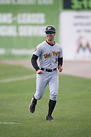 West Virginia Black Bears Jonathan Schwind (30) jogs back to the dugout after coaching first base during a game against the Batavia Muckdogs on June 25, 2017 at Dwyer Stadium in Batavia, New York.  Batavia defeated West Virginia 4-1 in nine innings of a scheduled seven inning game.  (Mike Janes/Four Seam Images)