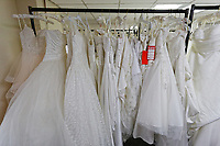 """COPY BY TOM BEDFORD<br /> Pictured: at the John Pye Auctions warehouse in Pyle, south Wales, UK.<br /> Re: A bride cried tears of joy after her missing wedding dress was found among a pile of 20,000 gowns in a warehouse.<br /> Meg Stamp, 27, paid £1,300 for the beautiful ivory lace dress but it  was seized by liquidators after a bridal company went bust.<br /> It was boxed up along with 20,000 others and due to be sold for a knock-down price at auction.<br /> But determined Meg banged on the auctioneer door saying: """"I want my dress back"""".<br /> Staff at John Pye auctioneers in Port Talbot spent three hours sifting through boxes until they finally found Meg's dream dress."""