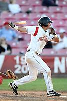 Salem-Keizer Valcanoes shortstop Joe Panik #12 bats against the Spokane Indians at Valcanoes Stadium on August 10, 2011 in Salem-Keizer,Oregon. Salem-Keizer defeated Spokane 7-6.(Larry Goren/Four Seam Images)