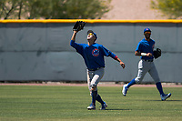 Chicago Cubs right fielder Kwang-Min Kwon (25) settles under a fly ball during an Extended Spring Training game against the Colorado Rockies at Sloan Park on April 17, 2018 in Mesa, Arizona. (Zachary Lucy/Four Seam Images)