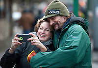 Four-time champion Lance Mackey, of Fairbanks, takes a selfie with a fan at the ceremonial start of the 43rd Iditarod dog sled race in downtown Anchorage. 79 mushers made their way 11 miles through the slushy streets of Anchorage in unseasonably warm weather and early rain. This year's official re-start will begin in Fairbanks because of poor trail conditions in Southcentral Alaska.