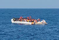 Sea Watch-2.<br /> Die Sea Watch-2 bei ihrer 13. SAR-Mission vor der libyschen Kueste.<br /> Im Bild: Ein Schlauchboot mit ca. 160 Menschen wird von der Sea Watch-Crew mit Rettungswesten versorgt.<br /> 20.10.2016, Mediterranean Sea<br /> Copyright: Christian-Ditsch.de<br /> [Inhaltsveraendernde Manipulation des Fotos nur nach ausdruecklicher Genehmigung des Fotografen. Vereinbarungen ueber Abtretung von Persoenlichkeitsrechten/Model Release der abgebildeten Person/Personen liegen nicht vor. NO MODEL RELEASE! Nur fuer Redaktionelle Zwecke. Don't publish without copyright Christian-Ditsch.de, Veroeffentlichung nur mit Fotografennennung, sowie gegen Honorar, MwSt. und Beleg. Konto: I N G - D i B a, IBAN DE58500105175400192269, BIC INGDDEFFXXX, Kontakt: post@christian-ditsch.de<br /> Bei der Bearbeitung der Dateiinformationen darf die Urheberkennzeichnung in den EXIF- und  IPTC-Daten nicht entfernt werden, diese sind in digitalen Medien nach §95c UrhG rechtlich geschuetzt. Der Urhebervermerk wird gemaess §13 UrhG verlangt.]