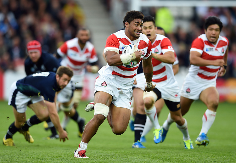 Amanaki Mafi of Japan goes on the attack. Rugby World Cup Pool B match between Scotland and Japan on September 23, 2015 at Kingsholm Stadium in Gloucester, England. Photo by: Patrick Khachfe / Stewart Communications