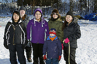 Saturday March 10, 2012 Marina Isaac, Faith Amend, Tamah Moses, Sandy Scotten, Hawken Scotten, Andrea Smith in Galena, Alaska:  volunteer dog lot attendants. Iditarod 2012.