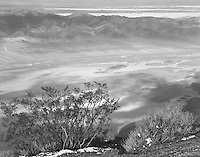 """""""Early Morning at Dantes Viewpoint"""" <br /> Death Valley National Park, California<br /> <br /> Death Valley National Park is a big place. Dantes viewpoint provides a terrific view of the valley more than a mile below and the mountains surrounding it. This black and white photograph was taken early in the morning when haze filled the valley and clouds provided interesting shadows on the terrain."""