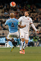 Melbourne, 21 July 2015 - Vincent Kompany of Manchester City and Mattia Destro of AS Roma jump for the ball in game two of the International Champions Cup match at the Melbourne Cricket Ground, Australia. City def Roma 5-4 in Penalties. (Photo Sydney Low / AsteriskImages.com)
