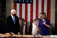 Speaker of the United States House of Representatives Nancy Pelosi (Democrat of California), and US Vice President Mike Pence talk before a joint session of the House and Senate convenes to confirm the Electoral College votes cast in November's election, at the Capitol in Washington, Wednesday, Jan. 6, 2021. <br /> Credit: J. Scott Applewhite / Pool via CNP/AdMedia