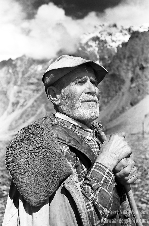 A shepherd poses for his photo in Tajikistan, Central Asia