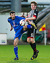 Stranraer's Martin Grehan and Pars' Lewis Martin challenge for the ball.