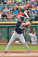 Dustin Martin (4) of the Reno Aces at bat against the Salt Lake Bees in Pacific Coast League action at Smith's Ballpark on July 24, 2014 in Salt Lake City, Utah.  (Stephen Smith/Four Seam Images)