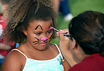 Lilyanne Lee, 7, gets her face painted at the Boys and Girls Club of Western Nevada booth at the 11th annual National Night Out hosted by the Carson City Sheriff's Office in Carson City, Nev., on Tuesday, Aug. 6, 2013. <br /> Photo by Cathleen Allison