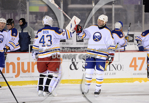 Richard Smehlik (42) and Martin Biron (43) greet each other after The Frozen Frontier Buffalo Sabres vs. Rochester Amerks Alumni Game at Frontier Field on December 15, 2013 in Rochester, New York.  (Copyright Mike Janes Photography)