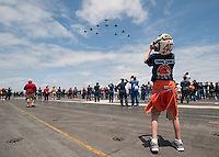 110611-N-DR144-594 PACIFIC OCEAN (June 11, 2011) Sailors' friends and family watch a formation of Carrier Air Wing 17 from the flight deck of the Nimitz-class aircraft carrier USS Carl Vinson (CVN 70) during the ship's Tiger Cruise air show.  Carl Vinson and Carrier Air Wing (CVW) 17 recently completed a deployment the U.S. 5th Fleet and U.S. 7th Fleet areas of responsibility. (U.S. Navy photo by Mass Communication Specialist 2nd Class James R. Evans / Released)