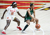 COLLEGE PARK, MD - DECEMBER 8: Ashley Owusu #15 of Maryland defends against Alexis Gray #20 of Loyola during a game between Loyola University and University of Maryland at Xfinity Center on December 8, 2019 in College Park, Maryland.