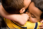 Education Preschool 4-5 year olds closeup of two boys friends giving each other a spontaeous hug horizontal