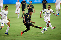 CARSON, CA - SEPTEMBER 06: Latif Blessing #7 of LAFC reaches the ball before Julian Araujo #22 of the Los Angeles Galaxy during a game between Los Angeles FC and Los Angeles Galaxy at Dignity Health Sports Park on September 06, 2020 in Carson, California.