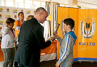 Rotterdam, The Netherlands, 07.03.2014. NOJK ,National Indoor Juniors Championships of 2014, 12and 16 years, Winner boys 12 years Jens Hoogendam (NED) receives the trophy out of the hands of Chris van Gennip<br /> Photo:Tennisimages/Henk Koster