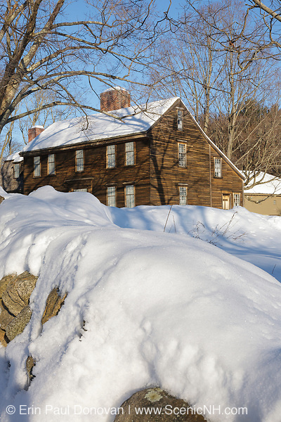 """Hartwell Tavern along the Battle Road at Minute Man National Historical Park in Lincoln, Massachusetts during the winter months. This is a restored 18th-century home and tavern. Originally built in 1732-1733, and restored by the National Park Service in the 1980s to its 18th-century appearance, this tavern was standing on April 19, 1775 (battles of Lexington and Concord, which marked the beginning of the American Revolutionary War). And because of this the National Park Service refers to this house as a """"witness house""""."""