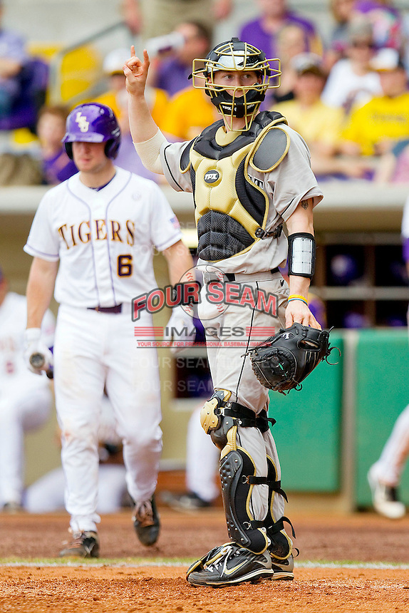 Catcher Brett Armour #6 of the Wake Forest Demon Deacons lets his defense know there are two outs against the LSU Tigers at Alex Box Stadium on February 19, 2011 in Baton Rouge, Louisiana.  The Tigers defeated the Demon Deacons 4-3.  Photo by Brian Westerholt / Four Seam Images