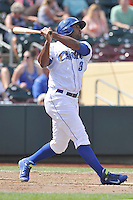 Carlos Peguero #39 of the Omaha Storm Chasers swings for a home run against the Las Vegas 51s at Werner Park on August 17, 2014 in Omaha, Nebraska. The Storm Chasers  won 4-0.   (Dennis Hubbard/Four Seam Images)