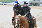 HOT SPRINGS, AR - APRIL 14:  Discreetness, winner of the Smarty Jones Stakes, jogs alongside trainer Jinx Fires as he prepares for his morning gallop at Oaklawn Park on April 14, 2016 in Hot Springs, AR. (Photo by Ciara Bowen/Eclipse Sportswire/Getty Images)