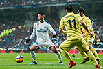 Isco Alarcon (L) of Real Madrid is tackled by Jaume Vicent Costa Jorda, J Costa (C) and Manuel Trigueros Munoz of Villarreal CF during the La Liga 2017-18 match between Real Madrid and Villarreal CF at Santiago Bernabeu Stadium on January 13 2018 in Madrid, Spain. Photo by Diego Gonzalez / Power Sport Images
