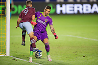 CARSON, CA - SEPTEMBER 19: Nicolas Benezet #9 of the Colorado Rapids attempts to move past David Bingham #1 GK of the Los Angeles Galaxy during a game between Colorado Rapids and Los Angeles Galaxy at Dignity Heath Sports Park on September 19, 2020 in Carson, California.