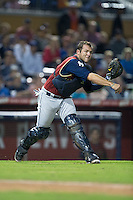 Scranton/Wilkes-Barre RailRiders catcher Austin Romine (7) makes a throw to first base against the Durham Bulls at Durham Bulls Athletic Park on May 15, 2015 in Durham, North Carolina.  The RailRiders defeated the Bulls 8-4 in 11 innings.  (Brian Westerholt/Four Seam Images)