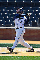AC Carter (13) of the Georgetown Hoyas follows through on his swing against the Marshall Thundering Herd at Wake Forest Baseball Park on February 15, 2014 in Winston-Salem, North Carolina.  The Thundering Herd defeated the Hoyas 5-1.  (Brian Westerholt/Four Seam Images)