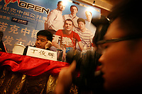 CHINA. Beijing. Ding Junhui sits bored as media photograph him at the press conference fpr the China Open. Ding won the tournament in 2005 and was automatically a national sporting icon. Snooker is a cue sport played on a large table measuring 3.6 metres x 1.8 metres. Originating in India in the late 19th Century where it was invented by British Army officers, the game has been a mainstay in British sport over the past few decades. Recently however, popularity of the sport has declined as the sport struggles to compete with other popular sports. The sport is however flourishing in countries such as China, where it is now the second most popular sport, behind Basketball. In a country where the  players are treated like movie-stars, China may be the great hope for the sports recovery. 2009