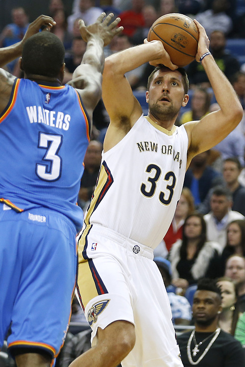 New Orleans Pelicans forward Ryan Anderson (33) shoots over Oklahoma City Thunder guard Dion Waiters (3) during the first half of an NBA basketball game Thursday, Feb. 25, 2016, in New Orleans. (AP Photo/Jonathan Bachman)