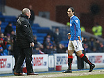 Bilel Mohsni apologises to Ally McCoist as he takes the long walk back to the dressing room after his red card