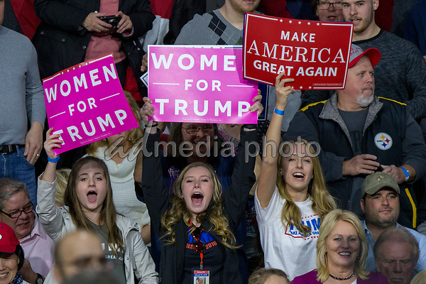 Supportes hold a campaign sign during a Make America Great Again campaign rally at Atlantic Aviation in Moon Township, Pennsylvania on March 10th, 2018. Photo Credit: Alex Edelman/CNP/AdMedia
