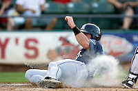 New Orleans Zephyrs catcher Vinny Rottino #4 slides safely home during the game against the Round Rock Express at the Dell Diamond on July 21, 2011 in Round Rock, Texas.  New Orleans defeated Round Rock 7-4.  (Andrew Woolley/Four Seam Images)