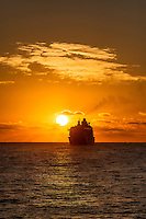 Cruse ship sails into the sunset.