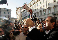 Il senatore e presidente dell'Italia dei Valori Antonio Di Pietro, a destra, parla al megafono durante la protesta dei lavoratori di ex Eutelia ed Agile, aziende appartenenti al gruppo Omega davanti a Palazzo Chigi, Roma, 17 novembre 2009..Italian senator and former magistrate Antonio Di Pietro, president of L'Italia dei Valori party, right, speaks on a megaphone during a protest attended by Eutelia and Agile (Omega group) workers in front of Chigi Palace, Rome, 17 november 2009..UPDATE IMAGES PRESS/Riccardo De Luca