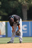 The Coastal Carolina University Chanticleers shortstop Tyler Motter #7 with his head down  after witnessing Christian Walker's 3 run homer to give the South Carolina Gamecocks a 10-9 lead that they would never relinqish. This was the 2nd and deciding game of the NCAA Super Regional vs. the University of South Carolina Gamecocks on June 13, 2010 at BB&T Coastal Field in Myrtle Beach, SC.  The Gamecocks defeated Coastal Carolina 10-9 to advance to the 2010 NCAA College World Series in Omaha, Nebraska. Photo By Robert Gurganus/Four Seam Images