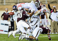 Ole Miss quarterback Bo Wallace (14) jumps over four Texas A&M defenders for a first down during second half of an NCAA football game, Saturday, October 11, 2014 in College Station, Tex. Ole Miss defeated Texas A&M 35-20. (Mo Khursheed/TFV Media via AP Images)