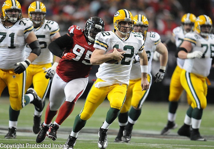 Green Bay Packers quarterback Aaron Rodgers scrambles for eight yards against the Atlanta Falcons during the third quarter of the game at the Georgia Dome in Atlanta, Ga., on Nov. 28, 2010.