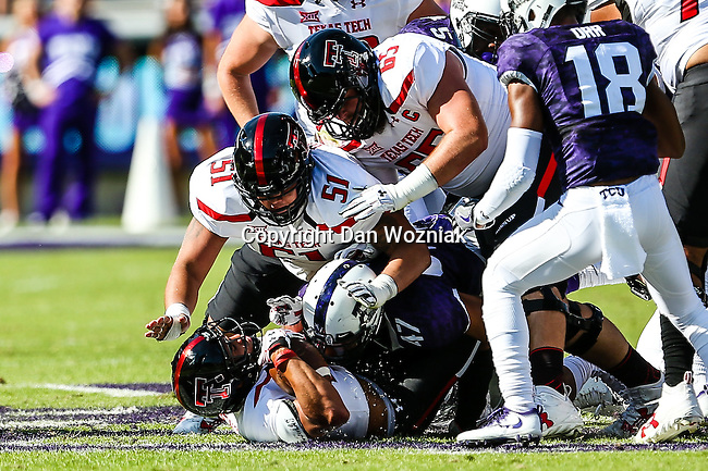 Texas Tech Red Raiders offensive lineman Baylen Brown (65) and Texas Tech Red Raiders offensive lineman Tony Morales (51) in action during the game between the Texas Tech Red Raiders and the TCU Horned Frogs at the Amon G. Carter Stadium in Fort Worth, Texas.