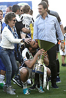 Calcio, Serie A: Juventus vs Crotone. Torino, Juventus Stadium, 21 maggio 2017.<br /> Juventus' Gonzalo Higuain, center, is caressed by his mother as he kisses the trophy during the celebrations for the victory of the sixth consecutive Scudetto at the end of the Italian Serie A football match between Juventus and Crotone at Turin's Juventus Stadium, 21 May 2017. Juventus defeated Crotone 3-0.<br /> UPDATE IMAGES PRESS/Isabella Bonotto