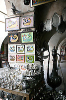 Antique market with framed shahmarans and silverware, Mardin, southeastern Turkey
