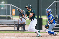 Oakland Athletics shortstop Jeremy Eierman (10) follows through on his swing in front of catcher Mario Trinci (6) during an exhibition game against Team Italy at Lew Wolff Training Complex on October 3, 2018 in Mesa, Arizona. (Zachary Lucy/Four Seam Images)
