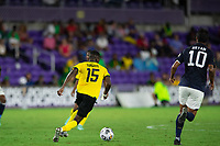 ORLANDO, FL - JULY 20: Blair Turgott #15 of Jamaica dribbles the ball during a game between Costa Rica and Jamaica at Exploria Stadium on July 20, 2021 in Orlando, Florida.