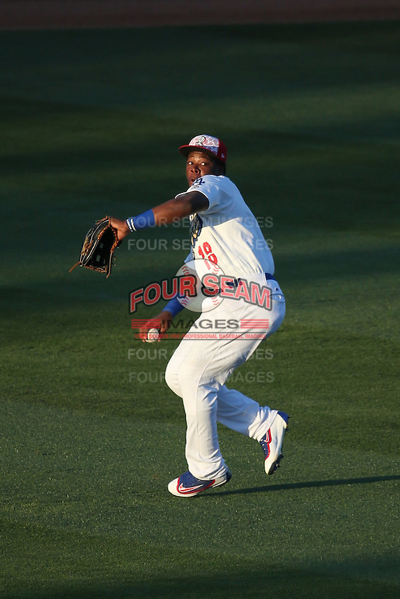 Johan Mieses (18) of the Rancho Cucamonga Quakes prepares to make a throw after catching a fly ball during a game against the Stockton Ports at LoanMart Field on July 3, 2016 in Rancho Cucamonga, California. Rancho Cucamonga defeated Stockton, 2-1. (Larry Goren/Four Seam Images)