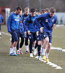 Kyle Hutton leads the players at training