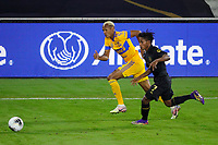 22nd December 2020, Orlando, Florida, USA;  Tigres Luis Quinones and LAFC Latif Blessing chase down the ball during the Concacaf Championship between LAFC and Tigres UANL on December 22, 2020, at Exploria Stadium in Orlando, FL.